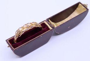 A late 19th cent gold bracelet with case en suite