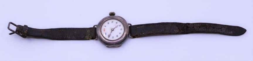 A Swiss silver cased lady's watch, the enamel did with Arabic mumerals, London 1920, no 143203