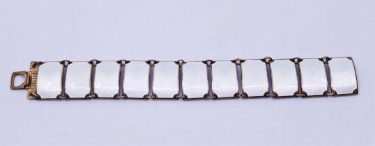 A David Anderson Norwegian silver gilt and white guilloche enamel bracelet of eleven rectangular