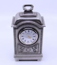 A pewter mantle clock, inscribed To Betty Boothroyd from NOAB 1999 Property of Baroness Boothroyd