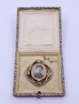 A gold brooch. boxed