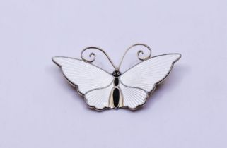 A David Andersen Norwegian sterling silver butterfly brooch, with ivory enamel and black body,