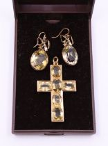 A yellow metal crucifix set citroine and associated pair of drop earrings, each set oval faceted