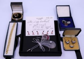 A Collection of Baroness Betty Boothroyds costume jewellery to include a blue stone ring and a green