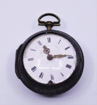 A late 18th century/ early 19th century pair cased pocket watch with enamel dial, Roman numerals