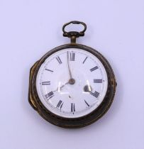 A gilt metal pocket watch, the gilt base metal case warn to show engraving of urn the enamel dial