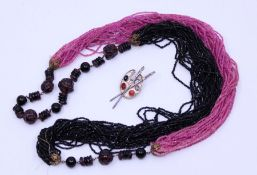 A collection of various vintage costume jewellery including a carved amethyst choker and similar