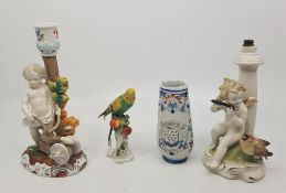 A Capodimonte budgerigar, together with a French faience posy vase, a 20th century Dresden lamp base
