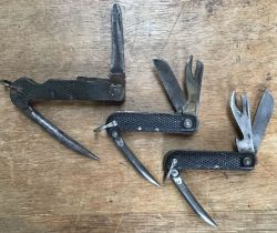 Three British military Combination tools one WW1 (unmarked) one WW2 dated 1943 and one post War