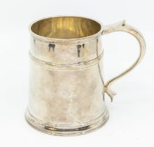 A George VI plain silver tapering tankard with upper section rib, scroll handle, hallmarked by