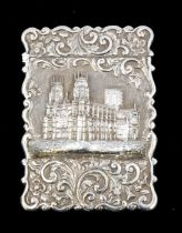 A Victorian silver card case, the front chased with York Minster in high relief on matted background