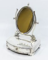 An Edwardian silver mounted dressing table mirror, oval mirror with central finial, fitted velvet