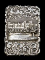 Nathaniel Mills: A Victorian silver castle top card case, the front chased in high relief with