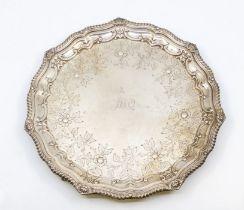 Irish Interest: An Irish early 20th Century silver salver, gadroon and shell raised scalloped