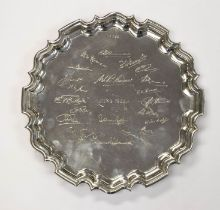 A George V silver salver, pie crust border on three scrolling feet, the centre with autograph