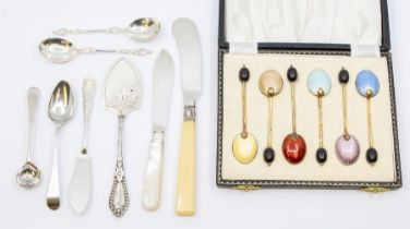 A set of six silver gilt and harlequin enamel coffee spoons, with bead terminals, hallmarked by