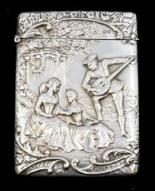 An Edwardian silver card case, the front chased with a group of 18th Century figures: two ladies