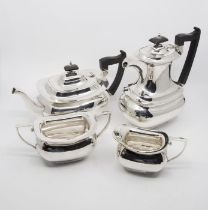 A Georgian style plain silver four piece tea and coffee service to include: teapot, coffee / hot