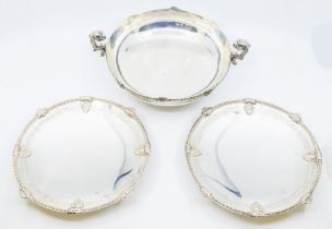 A George VI silver three piece garniture comprising two handled bowl and a pair of tazze, the