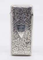 A Victorian silver cigar case, the body profusely engraved with ivy leaves, central shield shape