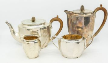 A George VI silver matched four piece tea service to include teapot, hot water or coffee pot,