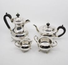 A George V plain silver four piece tea service to include: teapot, hot water jug, sugar bowl and