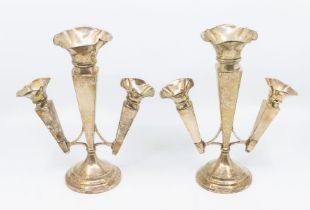 A pair of George V silver epergne vases, trumpet shaped with flared rims, central section flanked by