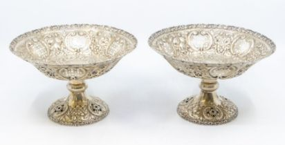 A pair of late Victorian silver tazze / bowls, shaped circular with openwork scrolling borders,