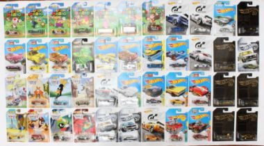 Hot Wheels: A collection of approximately 50 Hot Wheels long card vehicles to include: Super