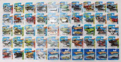 Hot Wheels: A collection of 50 modern Hot Wheels short carded vehicles including various sets: