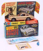 Corgi: A boxed Corgi Toys, James Bond's Aston Martin DB5, 261. Comes with two bandits, 'Top Secrets'