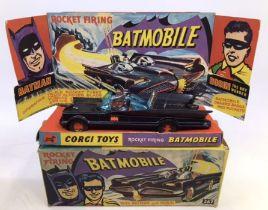 Corgi: A boxed Corgi Toys, Rocket Firing Batmobile, 267, first issue, with gloss black livery,