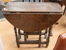 A late 17th Century small drop leaf oak table with turned legs, missing cutlery drawer