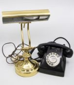 A brass desk lamp, and a 1970's telephone