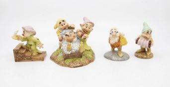 Four boxed Royal Doulton Snow White with the Seven Dwarfs figurines, English made