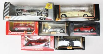 Diecast: A collection of seven boxed diecast vehicles to comprise: Maisto, Bburago and