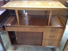 A 1950s teak sideboard and a similar coffee table