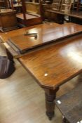 A Victorian oak wind-out table; with two extra leaves, on castors, length 150 cm, width 120cm,