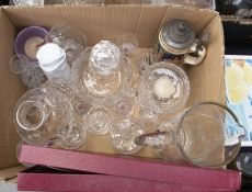 Collection of cut and crystal glass wares including decanters, large etched jug and stein