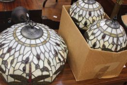 A collection of lighting to include a Tiffany style ceiling light, with two matching side table