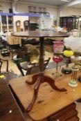 A 19th Century mahogany wine table on tripod legs