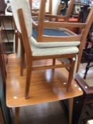 A 1950s kitchen table and four chairs in teak, with missing leaf
