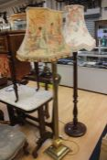 Two mid 20th Century standard lamps, one brass Corinthian column on lions feet, the other wooden