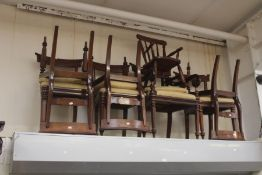 A late George IV set of six dining chairs plus one carver, all with padded seats, along with a small