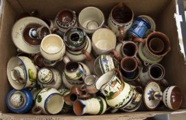 A quantity of Torquay pottery to include mugs, bowls, puzzle jug etc