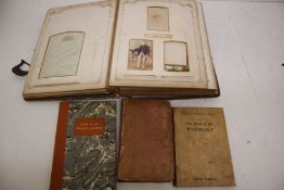 Victorian photo album with pictures, along with a collection of 19th Century books including