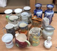 A large collection of ceramic jugs and vases, to include:- Wedgwood examples, Wadeheath and