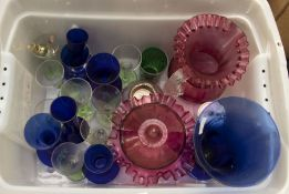 A collection of cobalt blue cut and moulded glass comprising vases, bowls, eye bathes etc together