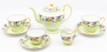 An Aynsley China B1544 part tea set to include teapot, two cups, 3 saucers, milk jug and sugar bowl,