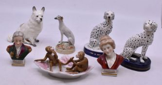 A Staffordshire Dalmatian, seated with chain lead, on an oval base; another, similar; a